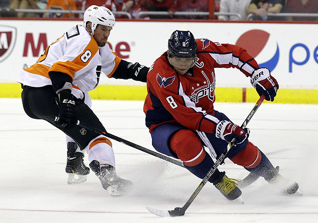 Alex Ovechkin (right) netted two goals to help the Capitals defeat Philadelphia.