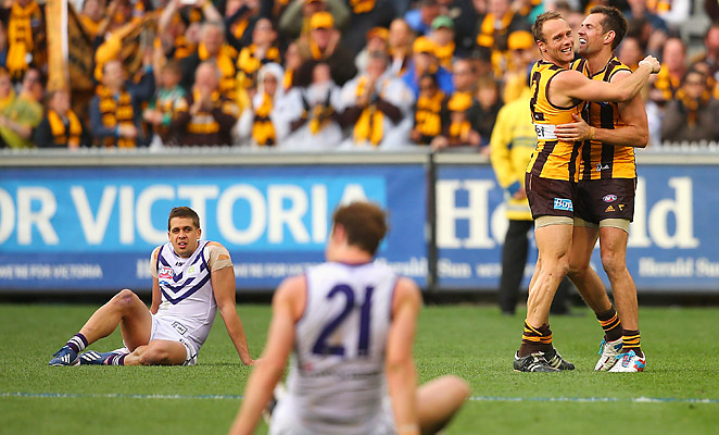 Luke Hodge and Brad Sewell (right) celebrate victory over the Dockers in the AFL Grand Final