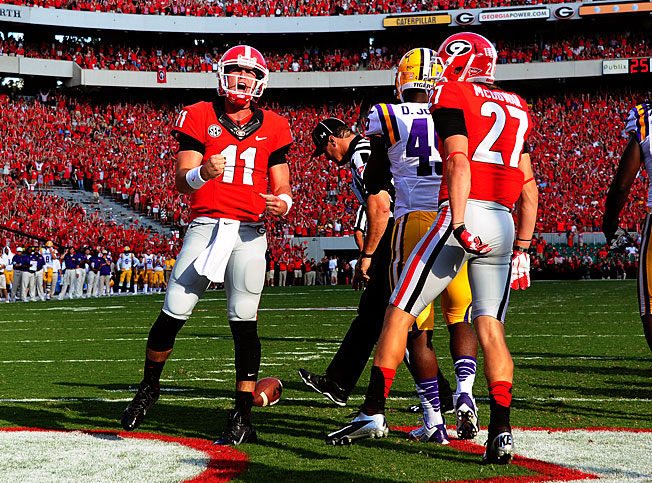 Aaron Murray (11) threw for 298 yards and four touchdowns to help Georgia outlast LSU in a shootout.
