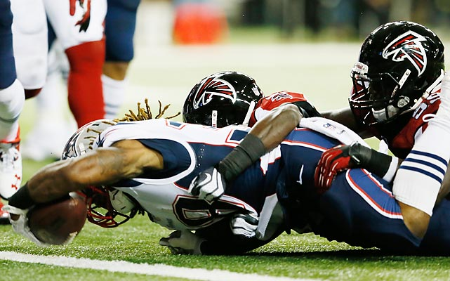 Brandon Bolden punctuated this run by spiking the ball in celebration, but learned upon replay review that his knee had touched down at the one before the ball crossed the plane of the end zone.