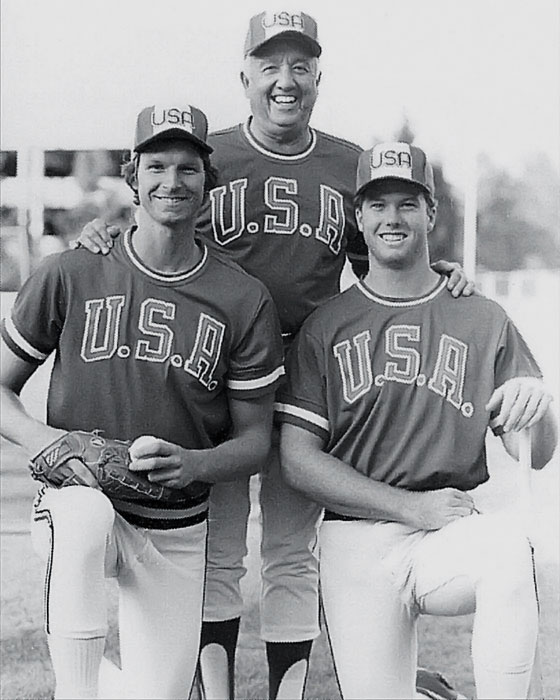 McGwire poses with Team USA baseball coach Rod Dedeaux and Randy Johnson.