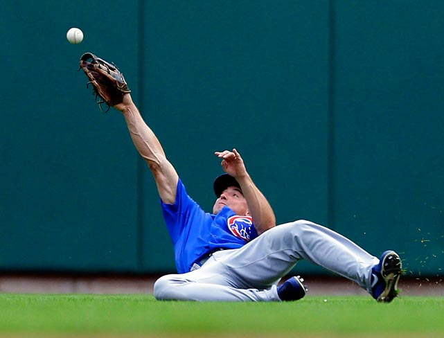Chicago Cubs center fielder Brian Bogusevic can't quite reach a ball hit by St. Louis Cardinals' third baseman Daniel Descalso.
