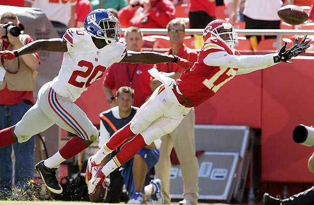 Kansas City Chiefs wide receiver Donnie Avery goes full extension but comes up just short, as New York Giants cornerback Prince Amukamara trails him in coverage.