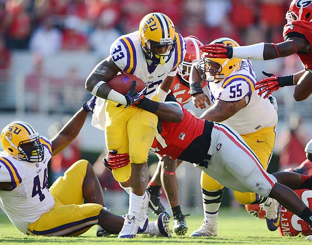 LSU running back Jeremy Hill carries the ball for the TIgers. Hill had 130 total yards and a score, but it wasn't enough as LSU fell to Georgia, 44-41 in Athens.