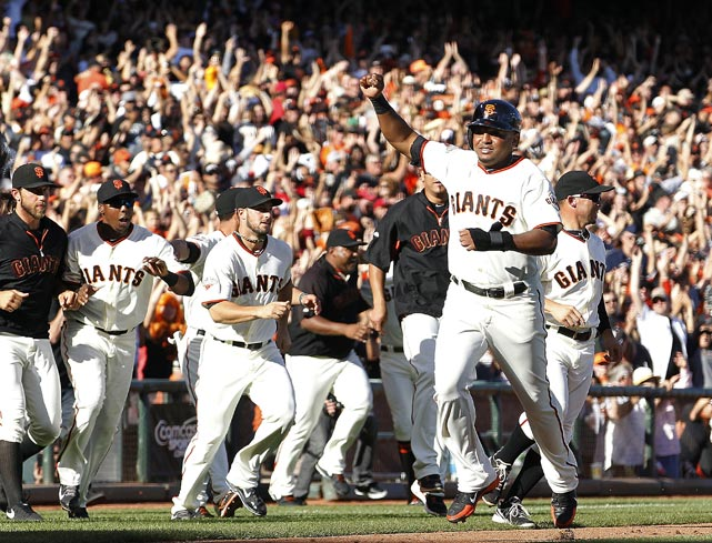 San Francisco Giants second baseman Tony Abreu celebrates as he scores the winning run on a single by Hunter Pence in the Giants' regular season finale.