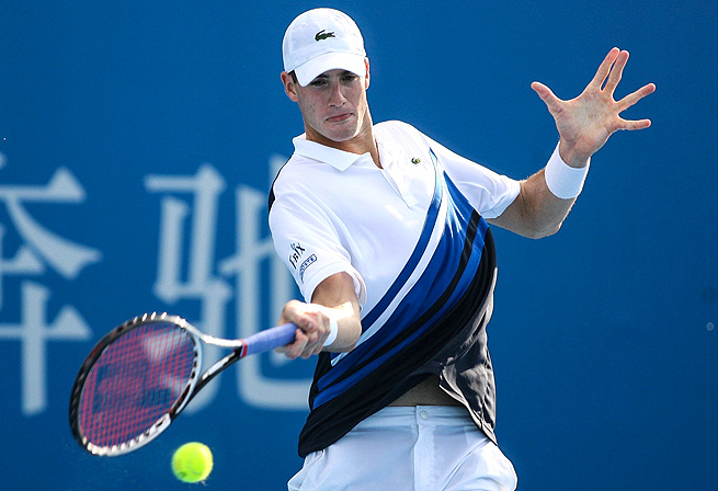 American John Isner defeated Spain's Roberto Bautista Agut in three sets in Beijing.
