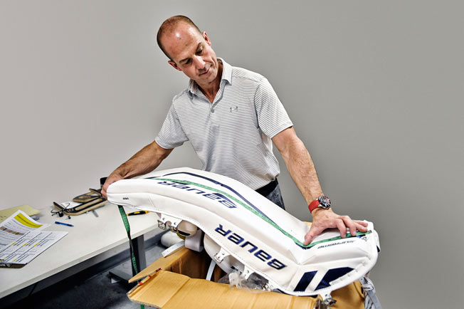 Size matters: NHL goalie cop Kay Whitmore determines whether goalie gear meets new regulations.