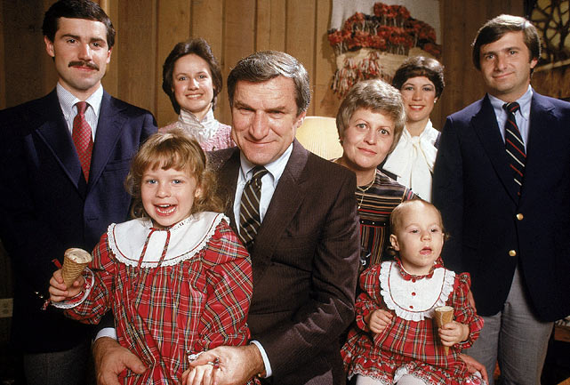 North Carolina basketball coach Dean Smith poses with his family in November 1982.