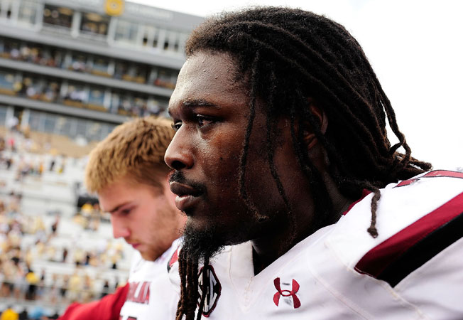 Jadeveon Clowney missed Saturday's game against Kentucky after telling Steve Spurrier he was in pain.