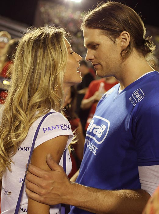 Tom Brady's hairstyle was a hot topic around the NFL during the 2010 season, and it looks like it will continue in the offseason as well. The Patriots quarterback showed off his new, diminutive ponytail at a parade in Rio de Janeiro, Brazil, with supermodel wife Gisele Bundchen.