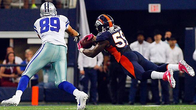 Danny Trevathan's diving interception of this Tony Romo pass set up the game-winning field goal for the undefeated Broncos.