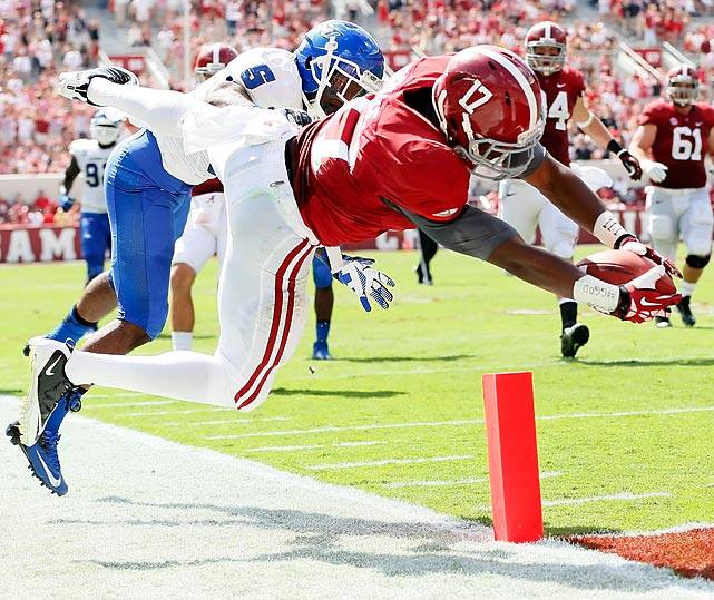 Alabama running back Kenyan Drake dives for a touchdown past Demarius Matthews of the Georgia State Panthers.