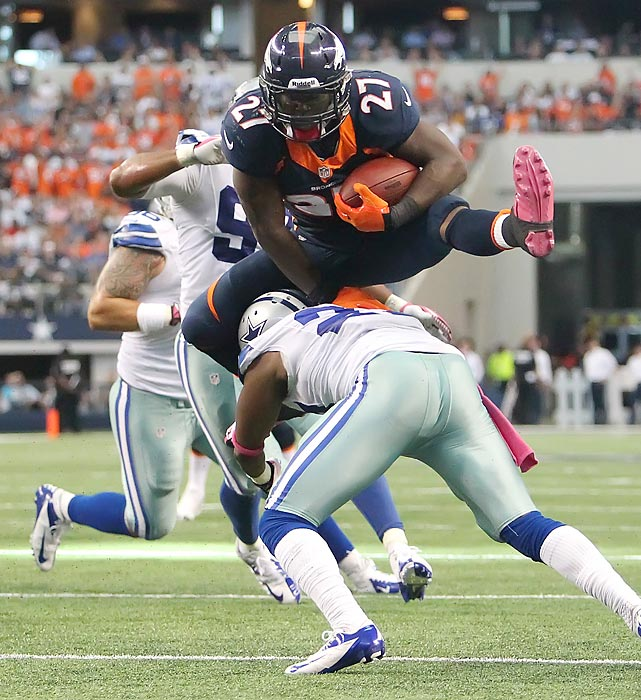 Denver Broncos running back Knowshon Moreno hurdles a Dallas Cowboys defensive player on his way to a touchdown.