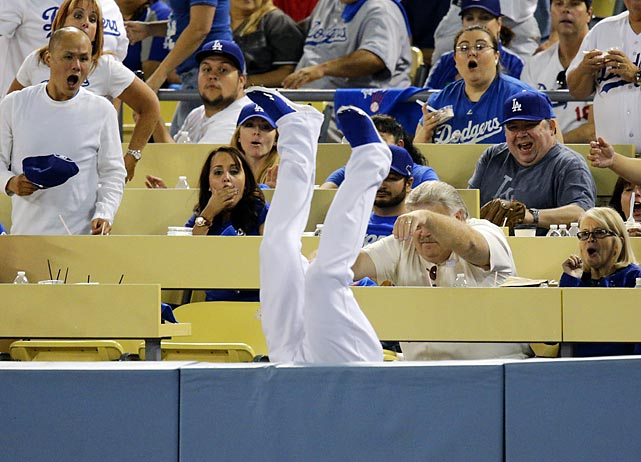 To the fans' amusement, Dodgers left fielder Carl Crawford went McCan over teakettle after snagging a foul ball launched by the Braves' Brian McCann in Game 3 of the NLDS in Los Angeles.