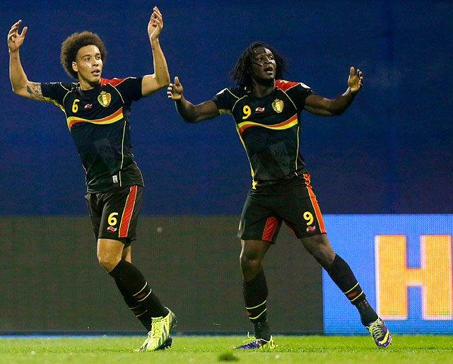 Romelu Lukaku (right) scored twice to ease Belgium to its first World Cup berth in 12 years. The Diables Rouges, or Rode Duivels, or Rote Teufel -- depending on what part of the trilingual country you ask -- defeated host Croatia, 2-1, on Friday to seal first place in UEFA's Group A and become the third European nation (and 11th overall) to book its place in Brazil.
