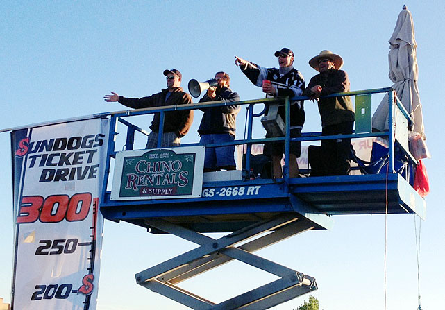 "Vowing to do ""whatever it takes"" to draw fans for the 2013-14 season, the owner, general manager, captain and marketing director of the Central Hockey League's Arizona Sundogs in Prescott Valley spent 144 hours on a five-by-eight-foot scissor-lift platform 25 feet above the ground until they reached their goal of 300 season tickets sold."