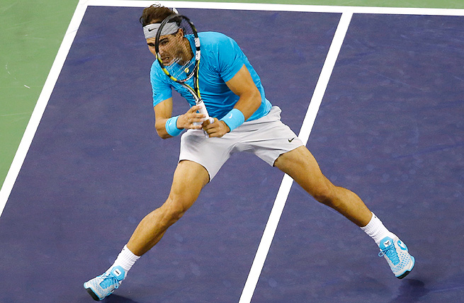 Rafael Nadal battled Stanislas Wawrinka for nearly 20 minutes in the first-set tiebreaker before running away with the second set.