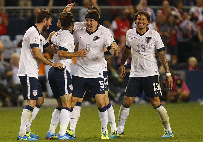 United States players celebrate following Graham Zusi's opening goal against Jamaica.