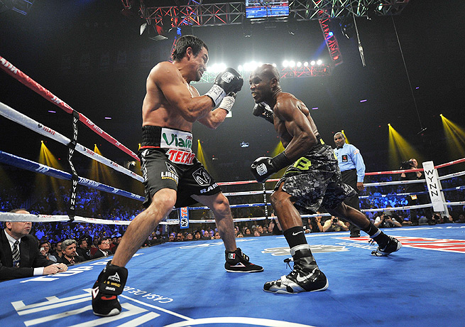 Timothy Bradley (right) earned a split decision over Juan Manuel Marquez remain welterweight champ.
