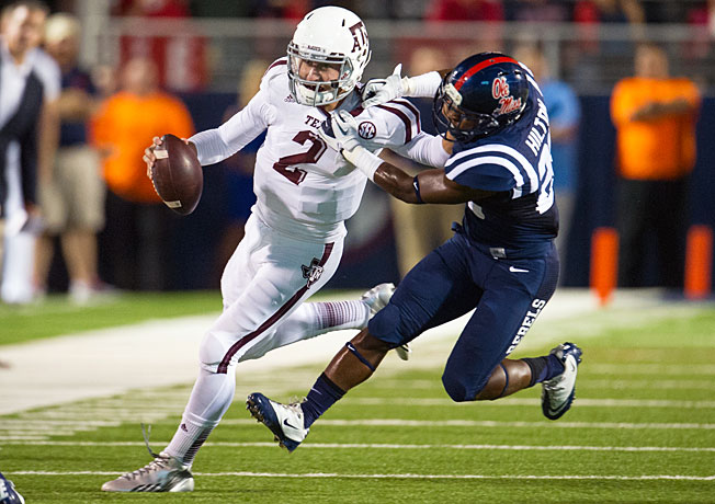 Johnny Manziel led two fourth-quarter scoring drives to help Texas A&M escape with a win at Ole Miss.