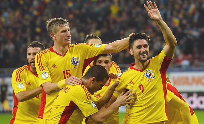 Ciprian Marica (right) scored twice to earn Romania a spot in the playoffs for a World Cup berth.