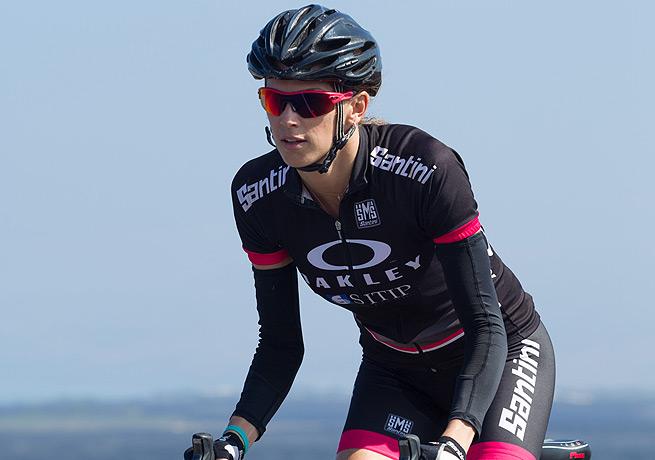 Pro triathlete Jenny Fletcher shows off her Oakley OO Red Iridium Polarized while training in Kona.