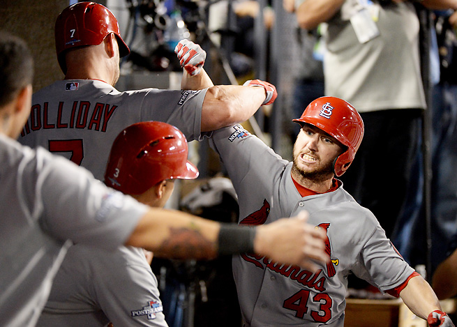 Matt Holliday and Shane Robinson (43) hit the first two home runs of a pitching-dominated NLCS.