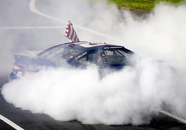 Brad Keselowski celebrates with a burnout after winning the NASCAR Sprint Cup Series Bank of America 500 at Charlotte Motor Speedway.