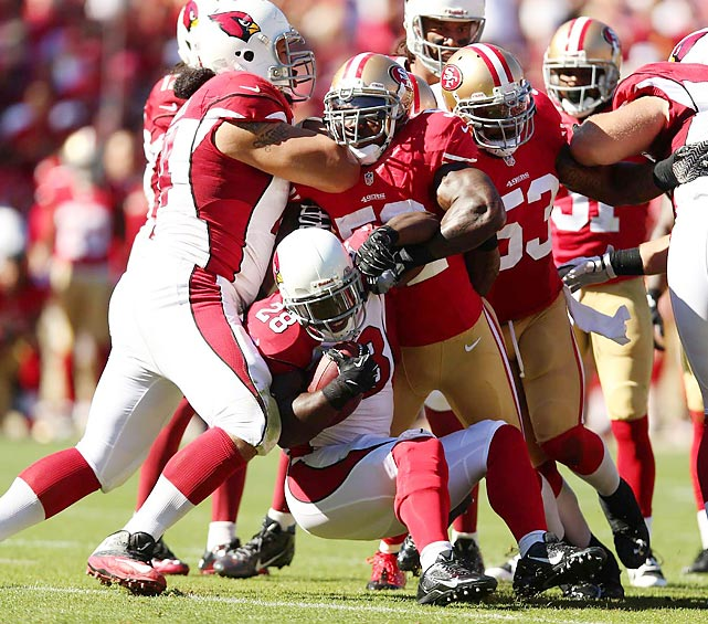 San Francisco linebacker Patrick Willis stands up Arizona running back Rashard Mendenhall. The 49ers won 32-20, thanks in part to four turnovers by the Cardinals.