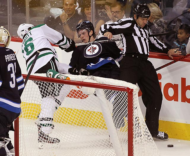 Ryan Garbutt of the Dallas Stars collides with Jacob Trouba of the Winnipeg Jets in the third period of a 4-1 Stars win.