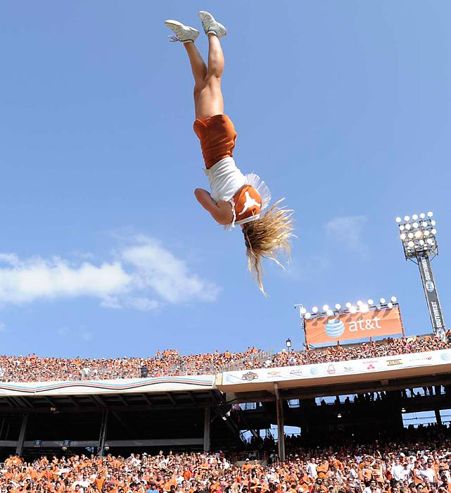 A Texas cheerleader goes airborne during the Red River Rivalry.