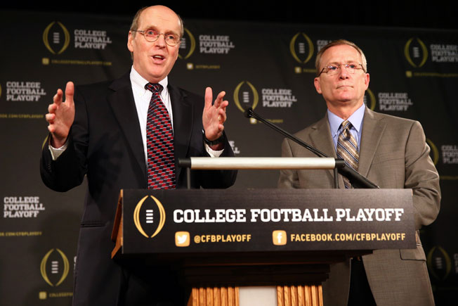 College Football Playoff executive director Bill Hancock (left) introduced Jeff Long as committee chair.