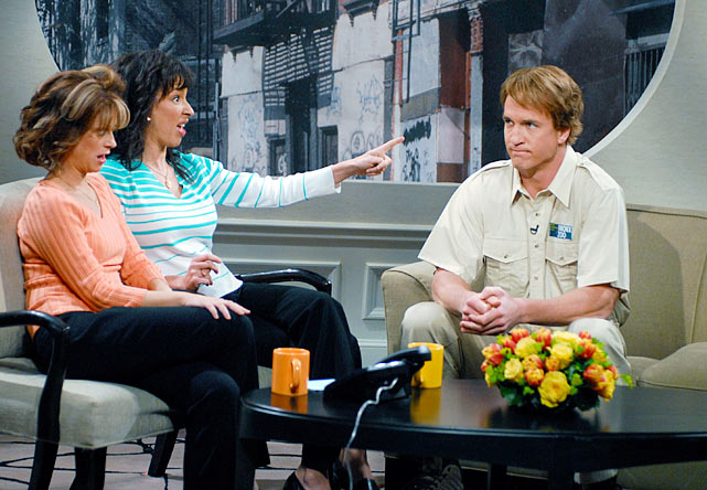 "While hosting <italics>Saturday Night Live</italics>, Manning plays an employee from the Bronx Zoo appearing on the talk show ""Bronx Beat."""