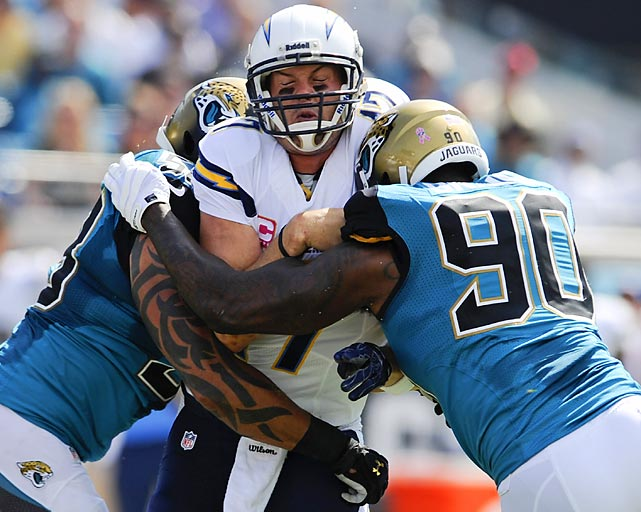 Jacksonville Jaguars defensive ends Jason Babin and Andre Branch sandwich San Diego Chargers quarterback Philip Rivers. The Jags lost 24-6 to drop to 0-7.
