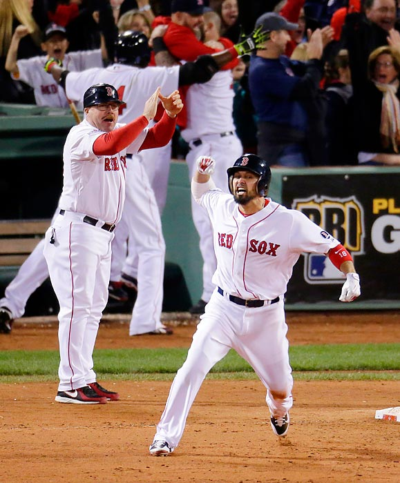 Boston Red Sox outfielder Shane Victorino celebrates his grand slam against the Detroit Tigers in the ALCS. Victorino's slam gave the Red Sox the lead in the seventh inning of the decisive Game 6.