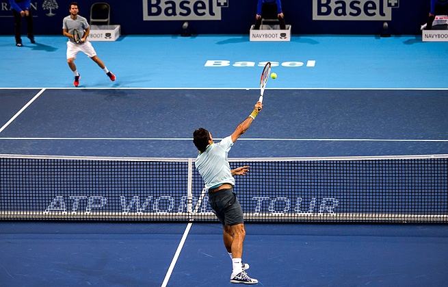 Roger Federer returns the ball to Adrian Mannarino in their first-round match at Swiss Indoors.