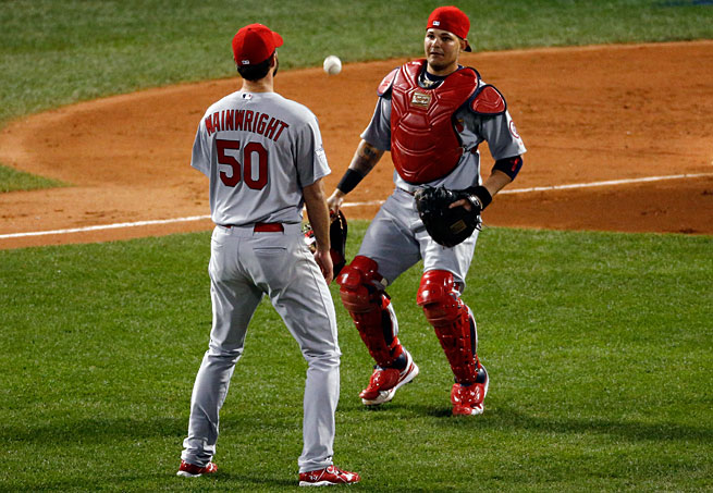 Adam Wainwright and Yadier Molina let a pop up fall, triggering a two-run second inning for Boston.