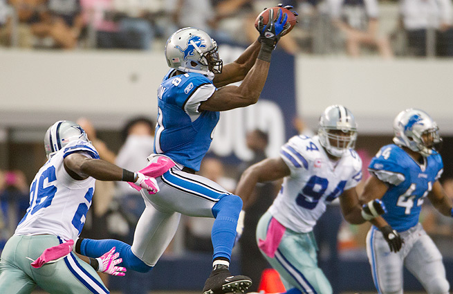 Calvin Johnson (center) and the Lions will face the Cowboys Sunday in what could be a high-scoring affair.