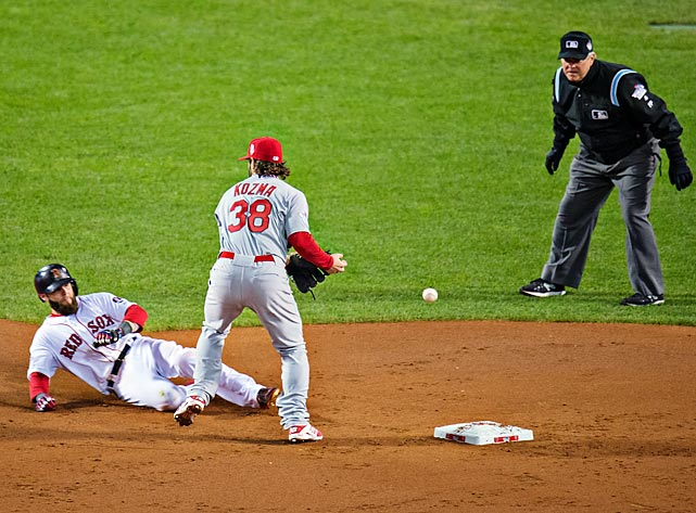 Cardinals shortstop Pete Kozma bobbles a potential double play ball in the first inning.