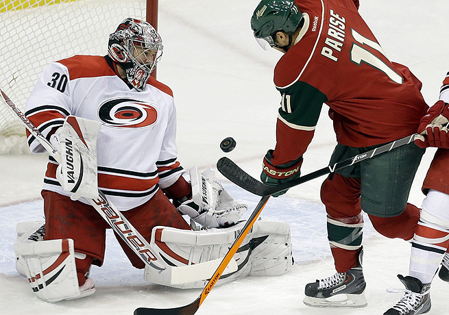 Cam Ward (left) was forced to exit Carolina's game against the Wild in Minnesota soon after it began.