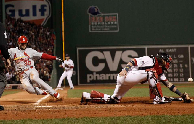 Pete Kozma (38) scores a run to begin the Cardinals' game-winning rally in the seventh inning.