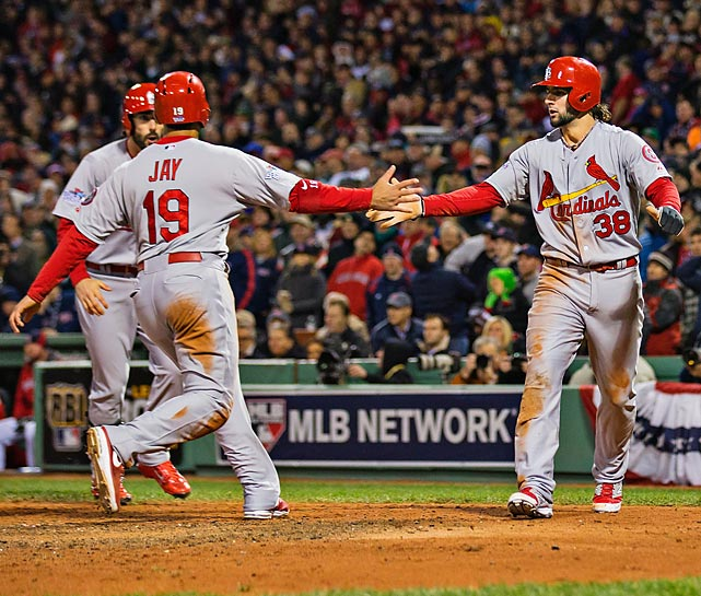 Jon Jay and Pete Kozma celebrate after scoring the tying and go-ahead runs.