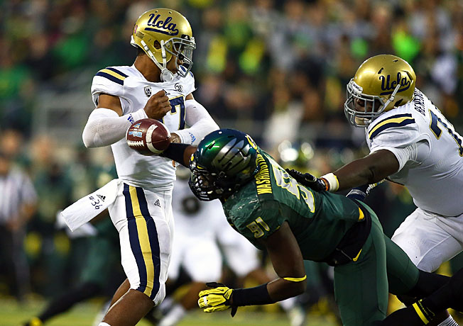 Oregon's defense kept UCLA quarterback Brett Hundley off balance all night in racing to a 42-14 victory.