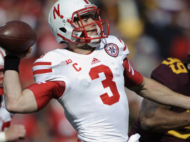 Taylor Martinez completed 16-of-30 passes for 139 yards and a score in Nebraska's loss to Minnesota.