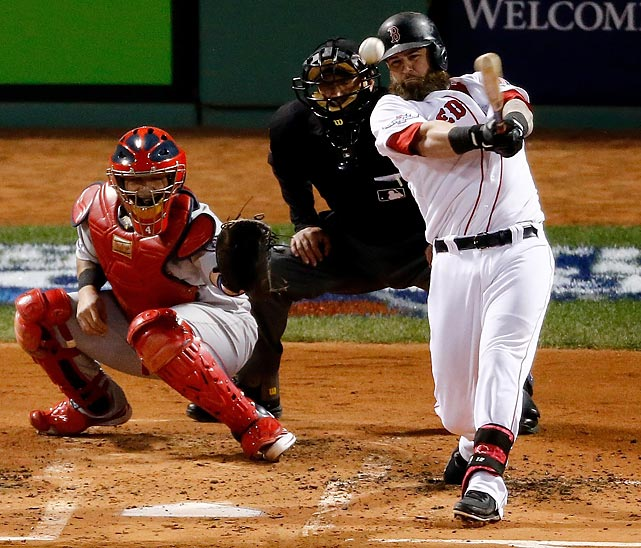 Red Sox first baseman Mike Napoli hits a three-run double in the first inning of World Series Game 1.