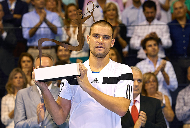 Mikhail Youzhny claimed his second title of the year by taking down the No. 1-seeded David Ferrer.