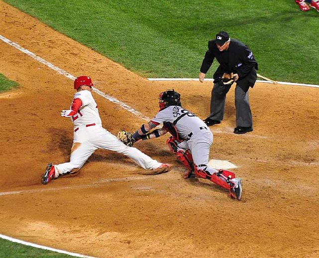 Saltalamacchia attempts to tag out Craig at the plate.