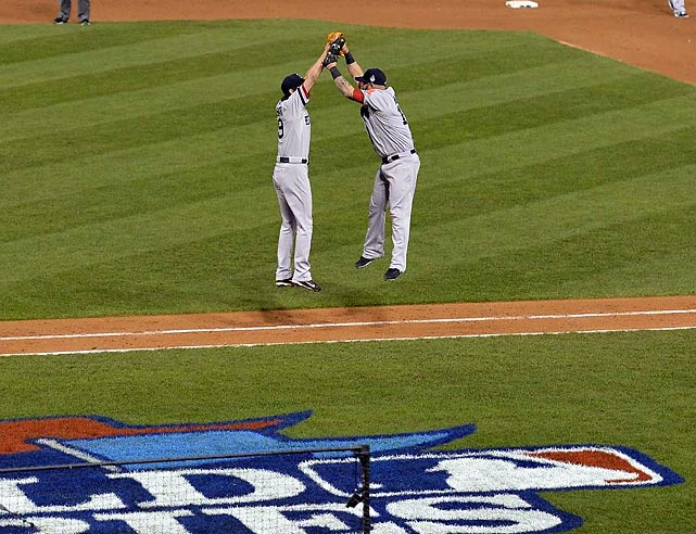 Uehara and Napoli celebrate after Boston's Game 4 win.