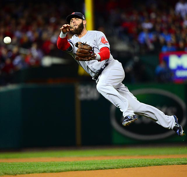 Dustin Pedroia goes airborne to make a throw.