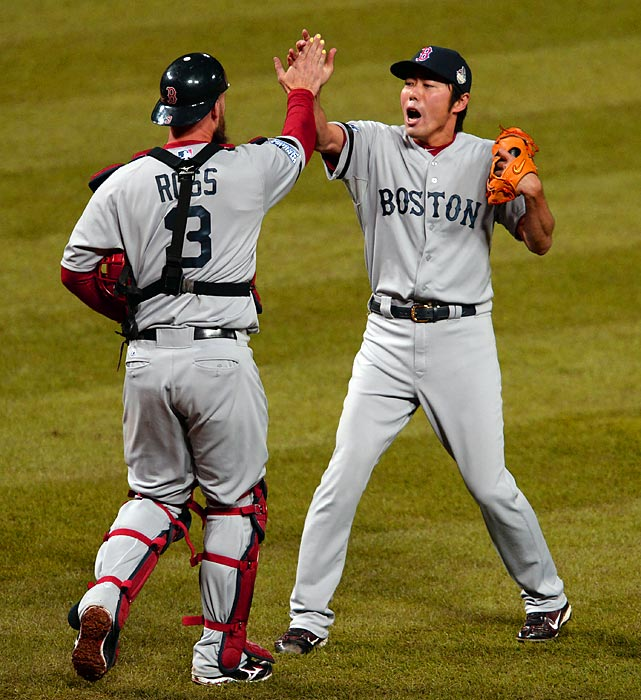 David Ross and Koji Uehara celebrate Boston's Game 5 win.